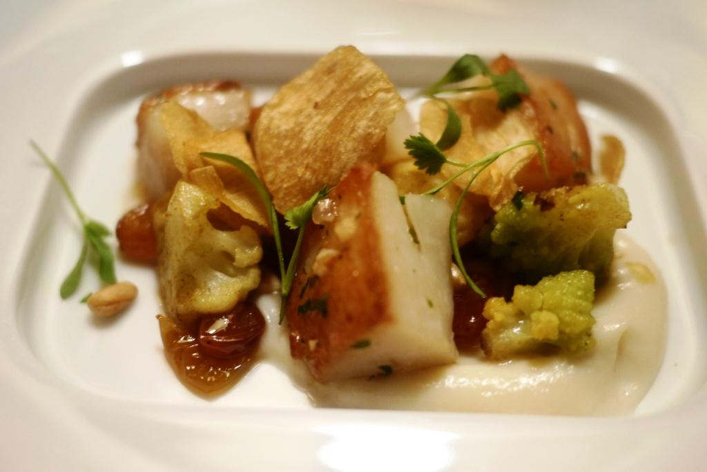 THE INN AT LITTLE WASHINGTON New England Day Boat Scallops Sauteed with Curried Cauliflower, Sultanas and Garlic Chips