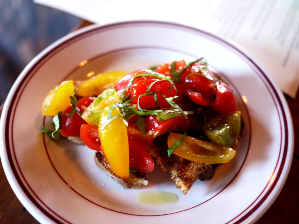 The Red Hen Crostini of Baby Tomatoes, Spring Onion and Basil