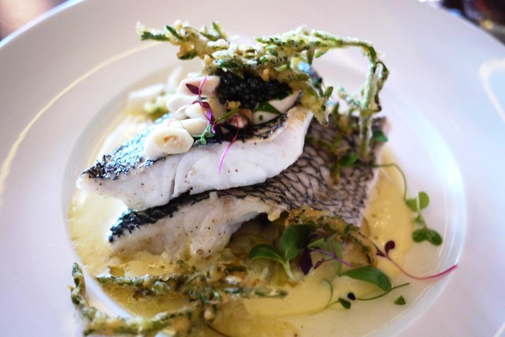 Olive oil poached black bass
