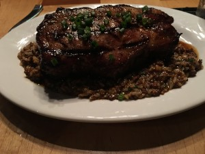 Toups pork chop with dirty rice