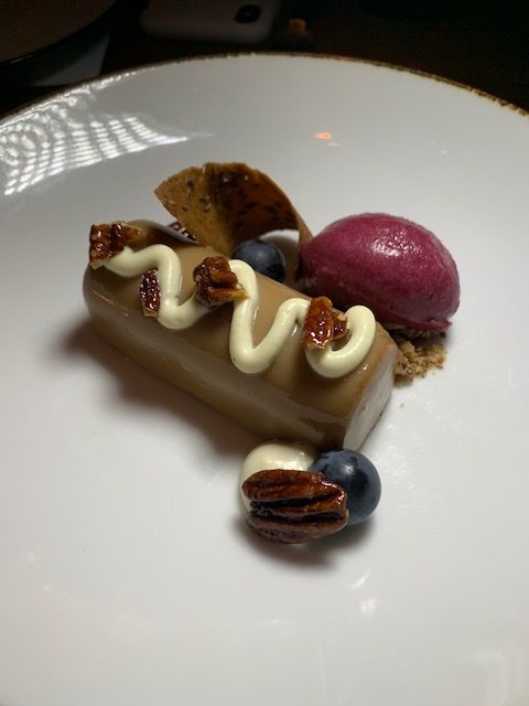 Blue Duck Tavern  candied pecan custard with concord grape sorbet